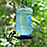 Black-Capped Chickadee on waterer feeder