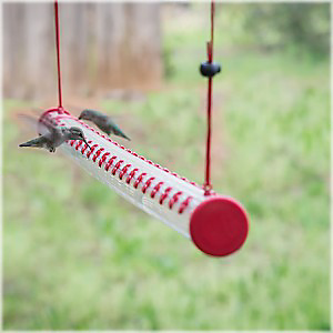 The Hummerbar® is a patented horizontal hummingbird feeder which allows multiple hummingbirds to feed at once.